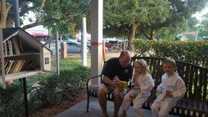 Twin children enjoy dedication of West U's most recent Little Free Library