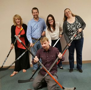 The Canady Team sends hockey sticks to soldiers