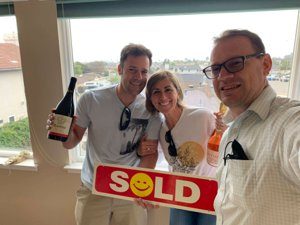 A photo of a sold home in Grover Beach with the new homeowners and the Fissori Real Estate Team