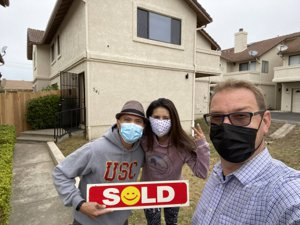 A photo of the sold home in Grover Beach with the new homeowners and the Fissori Real Estate team