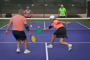Seniors playing pickle ball at Sun City Carolina Lakes