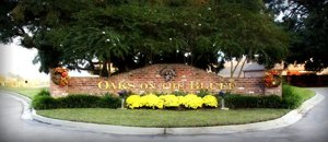 entrance of Oaks on the Bluff subdivision in Prairieville, LA