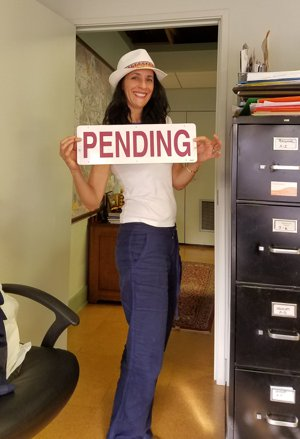 Lori Loria Hess of Roger Martin Properties with Pending real estate sign