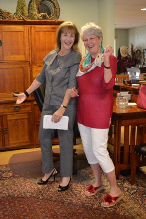 Gaye Jackson and Gretchen Morris display their outfits from The Charity Guild, Houston, TX 77006
