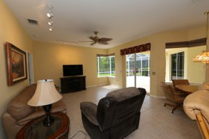 Long view of the family room with the lake in sight - 14124 Nighthawk Terrace - Lakewood Ranch