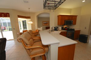 Kitchen and Table Space that overlooks the lake view - 14124 Nighthawk Terrace - Lakewood Ranch