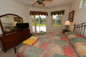 Master bedroom over looking the lanai and lake  - 14124 Nighthawk Terrace - Lakewood Ranch