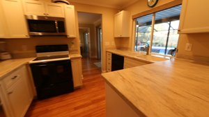 6577 Waterford Circle in Sarasota - New Kitchen overlooking the pool