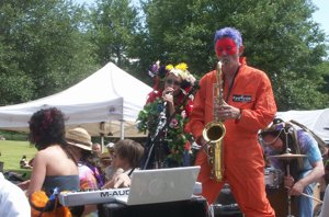 Inman Park Festival masked sax player on a float