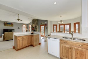 Granite counters, open plan to family room in this home for sale in Fairfax