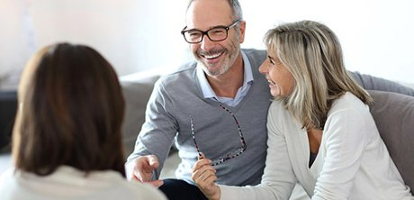 Couple meeting with a loan officer to discuss reverse mortgage loans