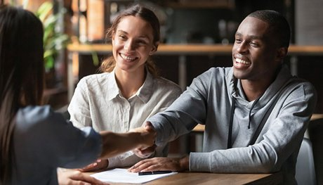 Couple meeting with a Lender For a Home Loan