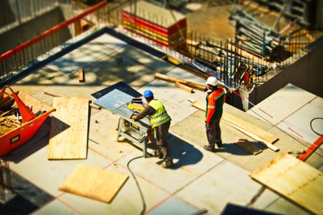 """Photograph of home construction team working on a urban redevelopment project to illustrate, """", """""""