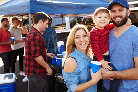 """Photographic Portrait Of Family Group Tailgating In Stadium Car Park to illustrate,"""""""
