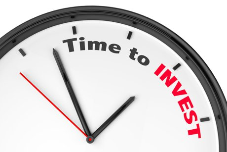 """Image of a clock face with the words """"time to invest"""" on it to illustrate, """"Real Estate Investing During A Seller's Market""""."""