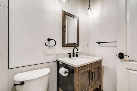 Space conscious rustic modern bathroom remodel with freestanding tub