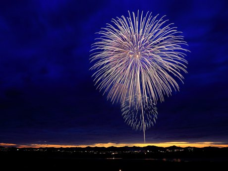 yellow fireworks over a town