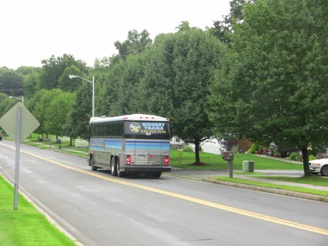 Several Buses Go By Monsey Trails, Coach Bus Versailles at Nanuet Townhouses and Condos in Rockland County NY 10954
