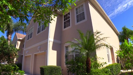 4015 Burlwood Rd in Sarasota is a wonderful end-unit townhouse in the gated community of Parkstone