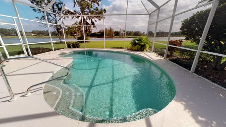 7125 River Club in Lakewood Ranch has a pool overlooking a spectacular lake front setting