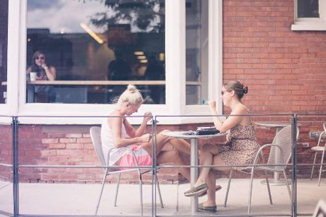 Two women sitting across from each other at a table.