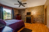 Master suite with exposed brick
