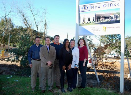 The Key Insurance team standing in front of their new office location