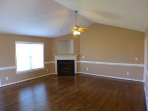 Family room with gas log fireplace in 113 JJ Dr Benson NC 27504